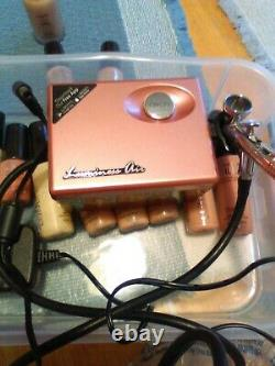 Luminess airbrush system used pink with lots of bottles used blush one not open